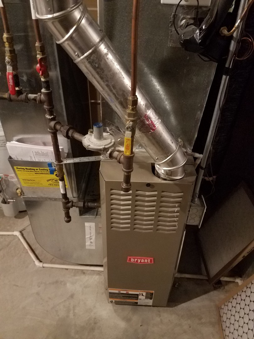Otsego, MN - Furnace maintenance. Performed tune up on a Bryant furnace. Installed a new ignition assembly, blower motor booster and a blower wheel cleaning.