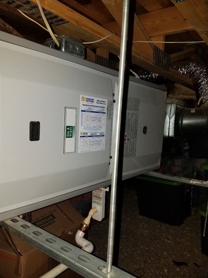 Elk River, MN - Furnace maintenance. Performed tune up and cleaning on a Day & Night furnace. Installed a new inducer motor, blower motor and cleaned the blower wheel housing