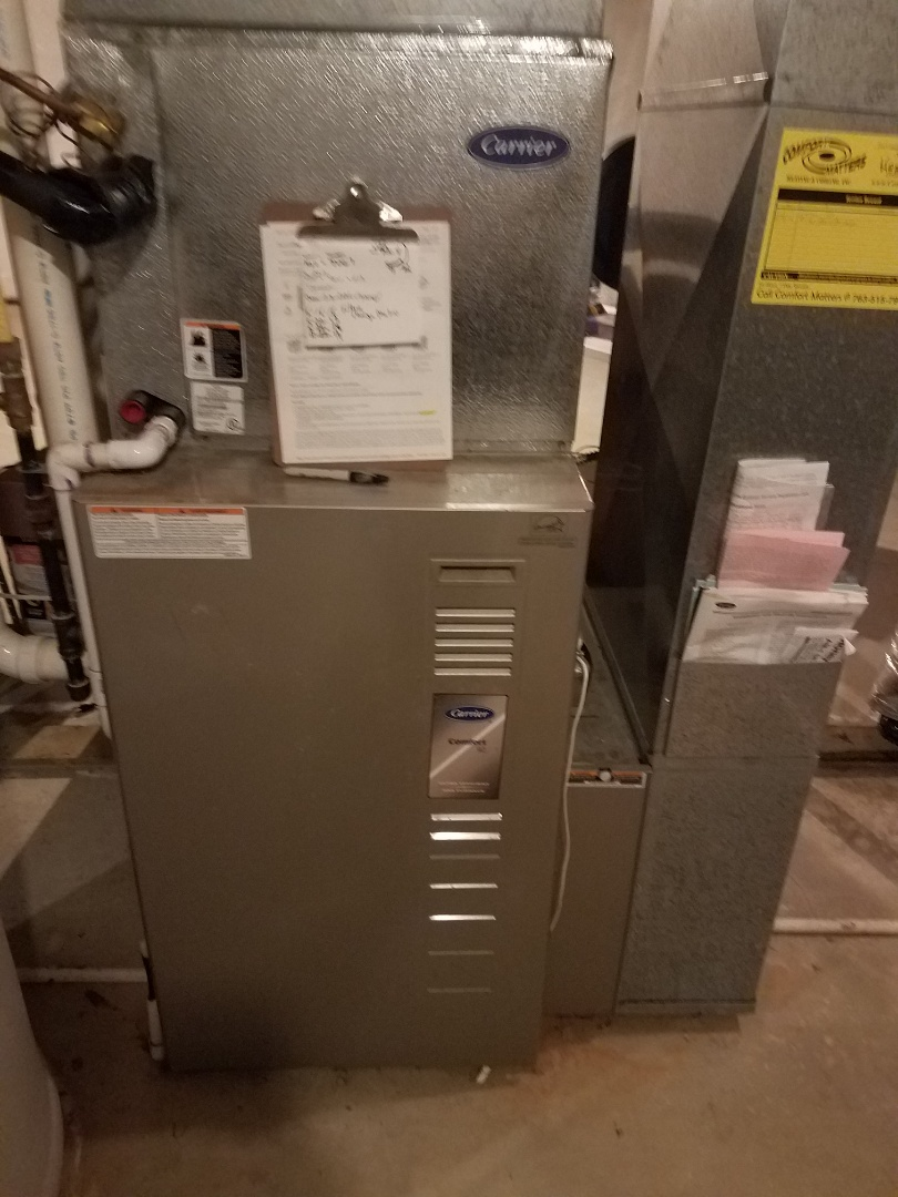 Plymouth, MN - Heating maintenance. Performed cleaning and tune up on a Carrier furnace.