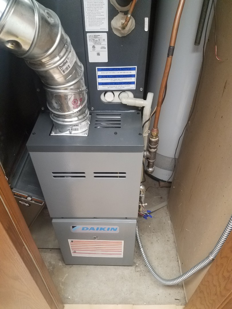 Minnetonka, MN - Furnace maintenance. Performed tune up and cleaning on a Daikin furnace.