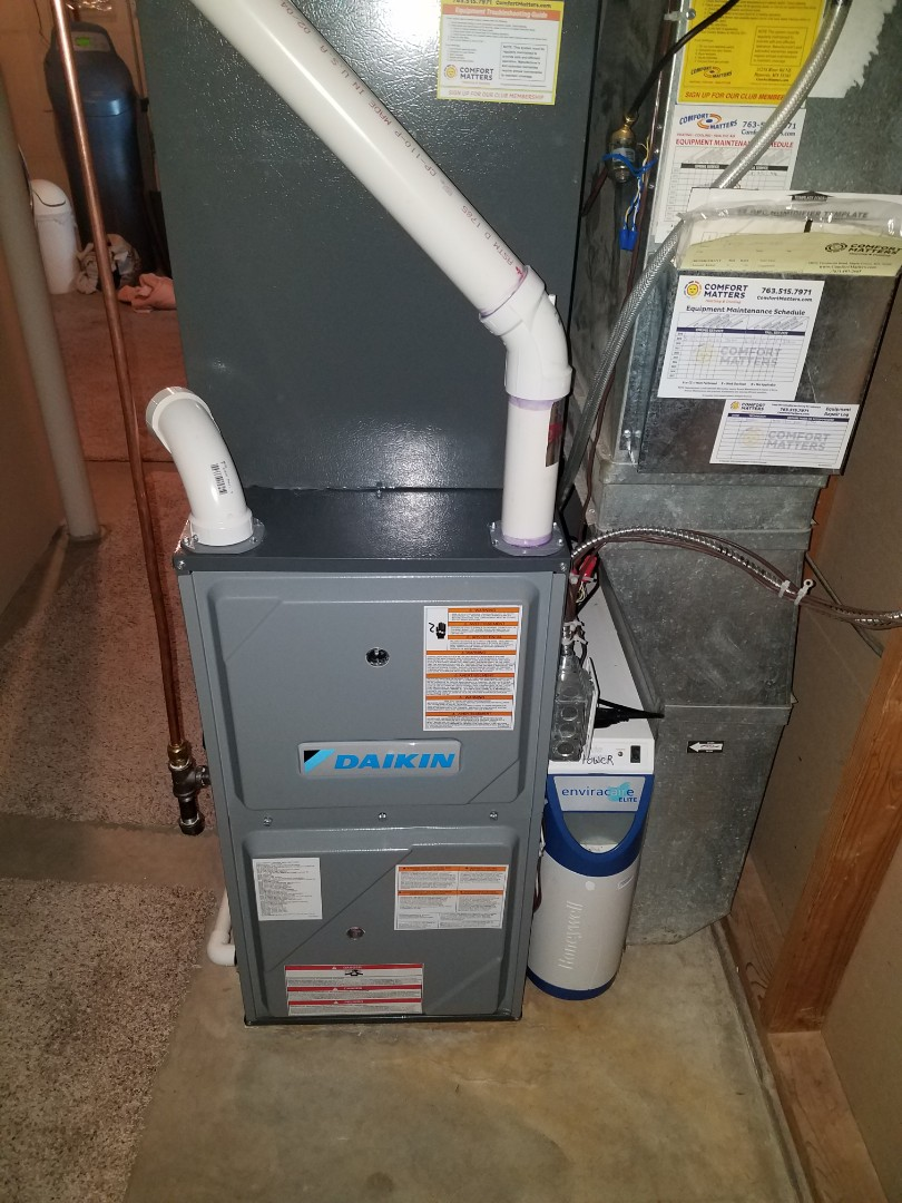 Furnace maintenance. Replaced a failed main flame safety sensor and performed a tune up and cleaning on a Daikin furnace.