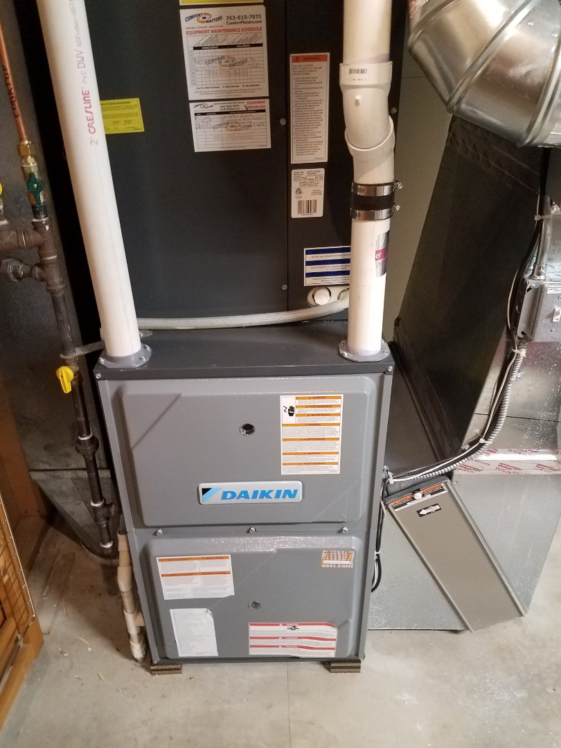 Hanover, MN - Heating maintenance. Performed tune up and cleaning on a Daikin furnace. Replaced furnace filter, main flame safety sensor and installed ECM surge protector.