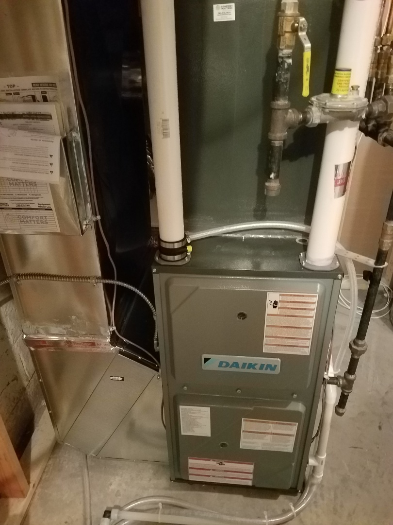 Wayzata, MN - Heating maintenance. Performed cleaning and tune up on a Daikin furnace. Performed humidifier tune up on a Aprilaire whole home humidifier.