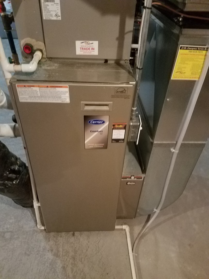 Elk River, MN - Heating maintenance. Performed cleaning and tune up on a Carrier furnace.