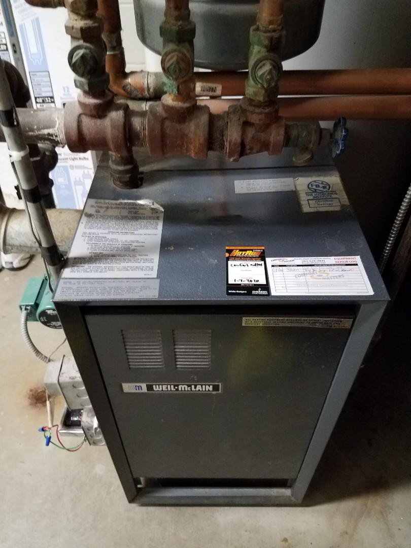 Rockford, MN - Boiler maintenance. Installed a new ignition assembly and a new temperature and pressure gauge on a Weil McLean boiler.