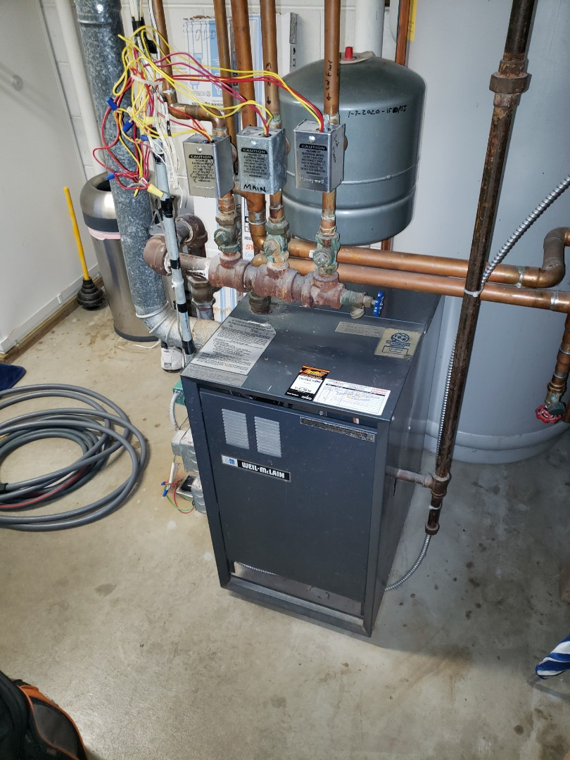Rockford, MN - Boiler service. Purged air, filled with water on a Weil - McLain.