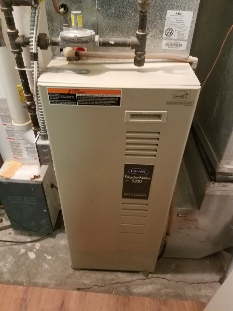 Elk River, MN - Furnace maintenance. Diagnosed and cleaned the condensate trap on a Carrier furnace.