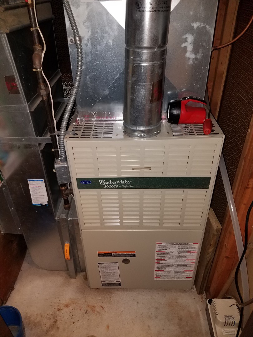 Minnetonka, MN - Heating maintenance. Performed cleaning and tune up on a Carrier furnace.