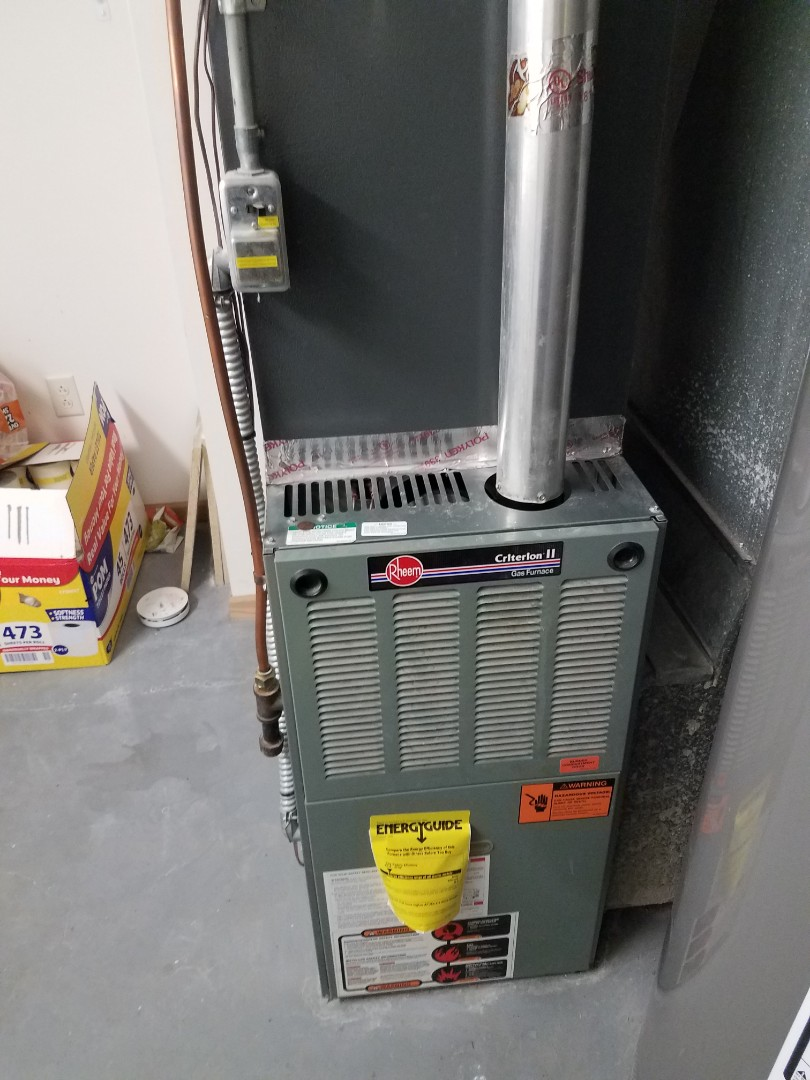 Champlin, MN - Furnace maintenance. Performed tune up and cleaning on a Rheem furnace. Pulled and cleaned blower section.