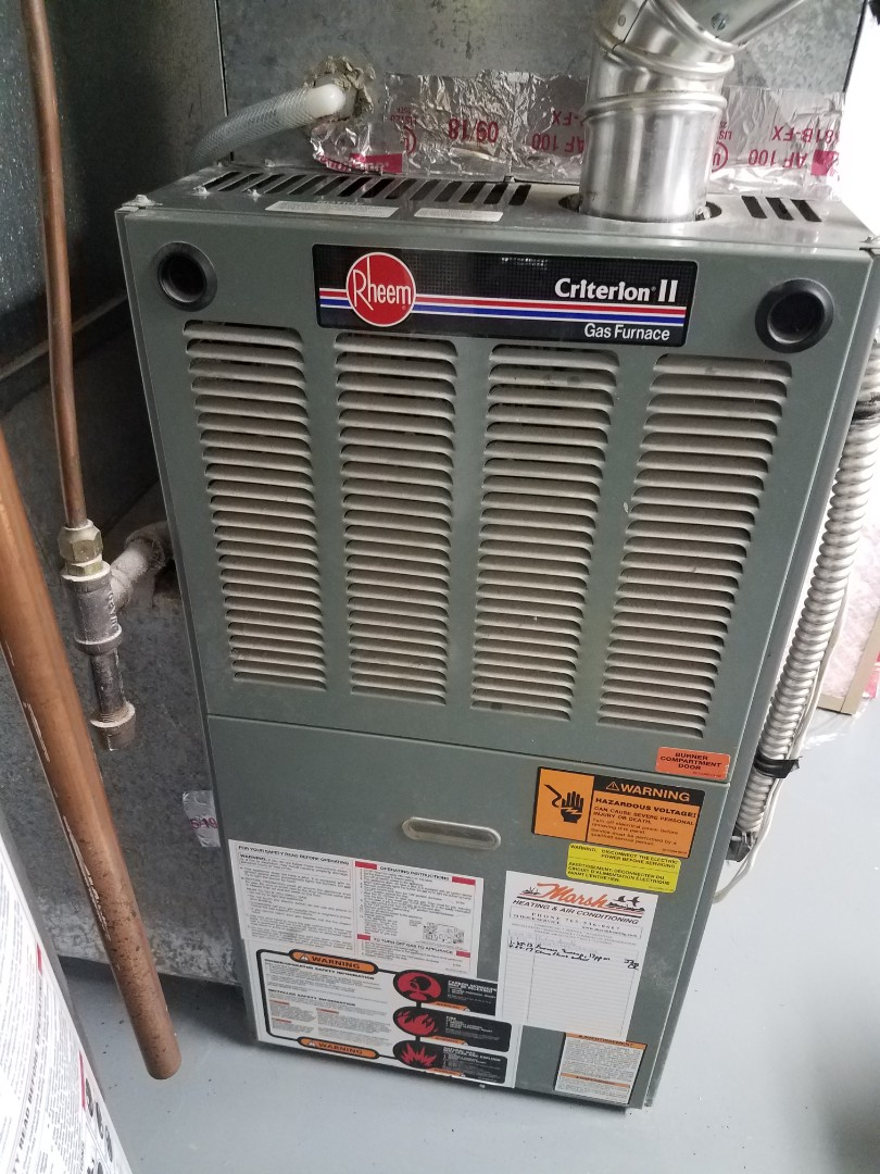 Champlin, MN - Heating maintenance. Performed cleaning and tune up on a Rheem furnace.