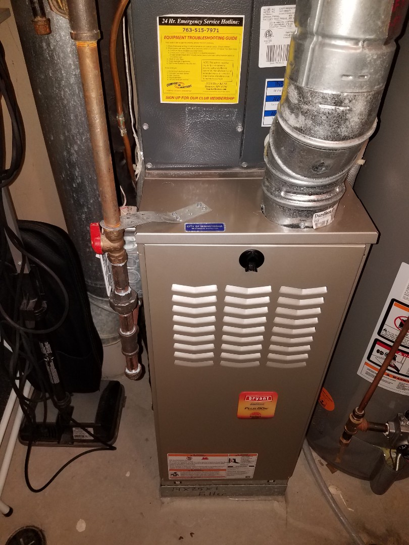 Minnetonka, MN - Furnace maintenance. Performed tune up and cleaning on a Bryant furnace.