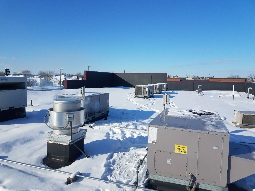Albertville, MN - RTU maintenance and cleaning on 8 package units in Albertville