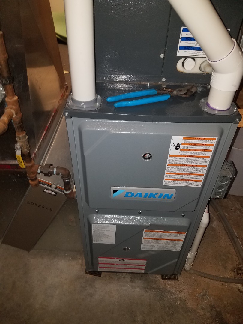 Loretto, MN - Furnace maintenance. Performed tune up and cleaning on a Daikin furnace. Air exchanger maintenance. Performed cleaning and tune up on a Renewaire air exchanger.