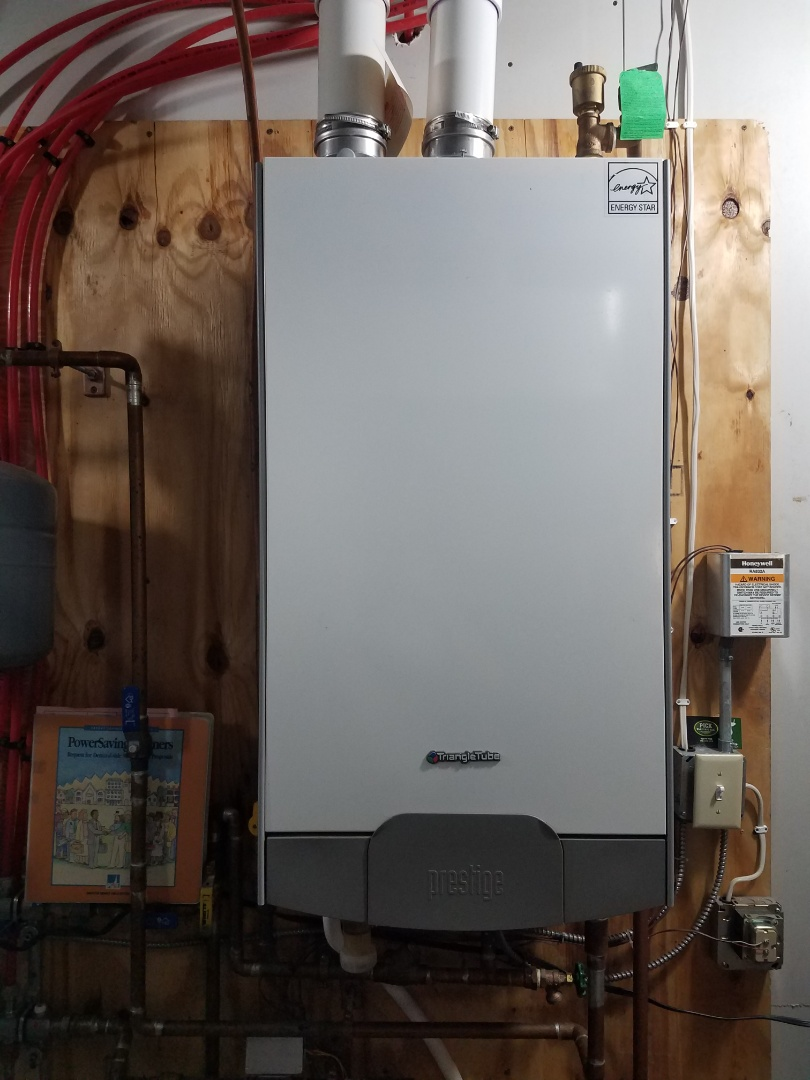 Rockford, MN - Boiler maintenance. Cleaned heat exchanger, installed a new ignitor and performed tune up and cleaning on a Triangletube boiler.