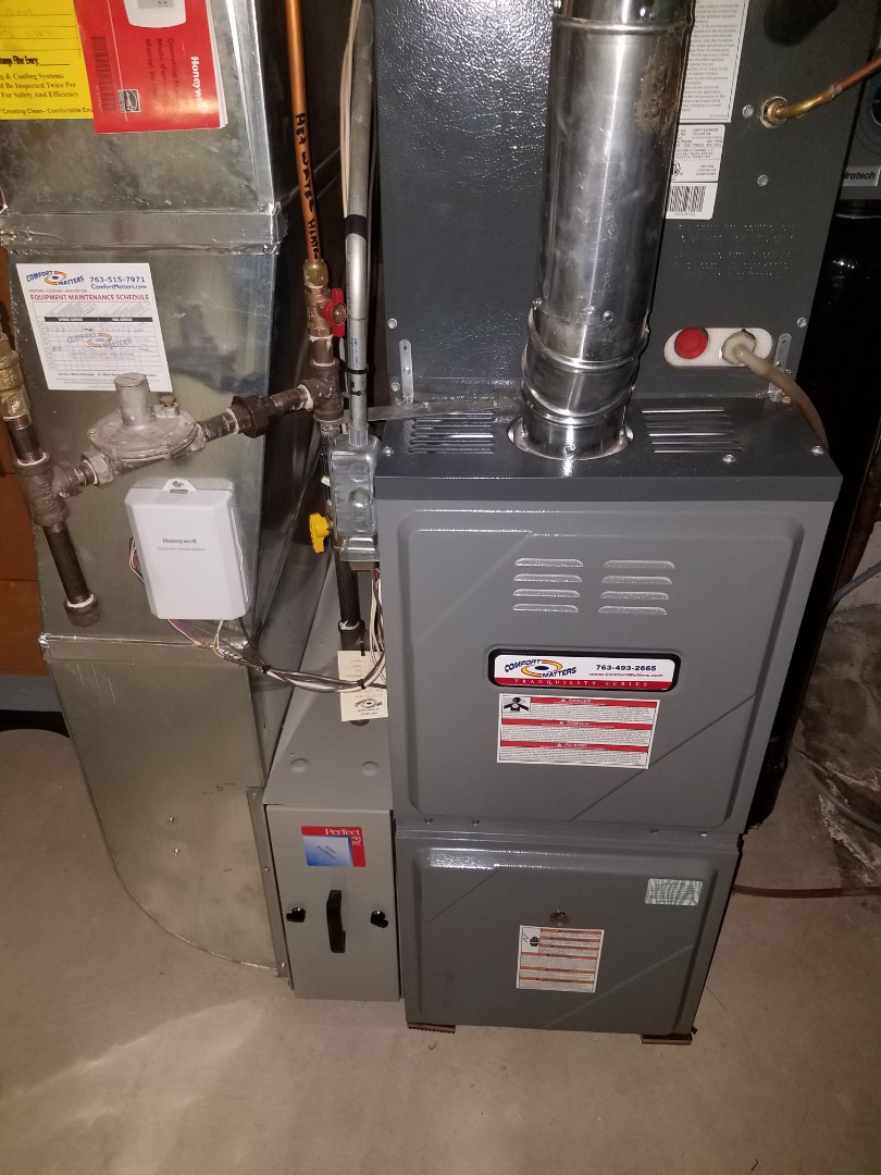 Fridley, MN - Furnace maintenance. Performed tune up and cleaning on a Comfort Matters furnace. Performed tune up and cleaning on a Trane humidifier.