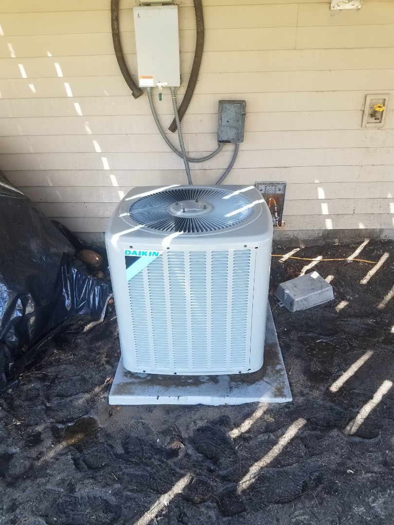 Andover, MN - Cooling maintenance. Performed cleaning and tune up on a Daikin AC.