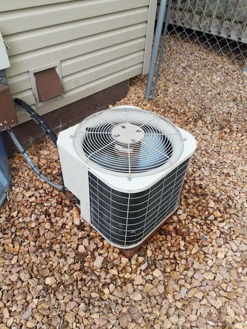 Plymouth, MN - Cooling maintenance. Performed tune up and cleaning on a Bryant air conditioner.