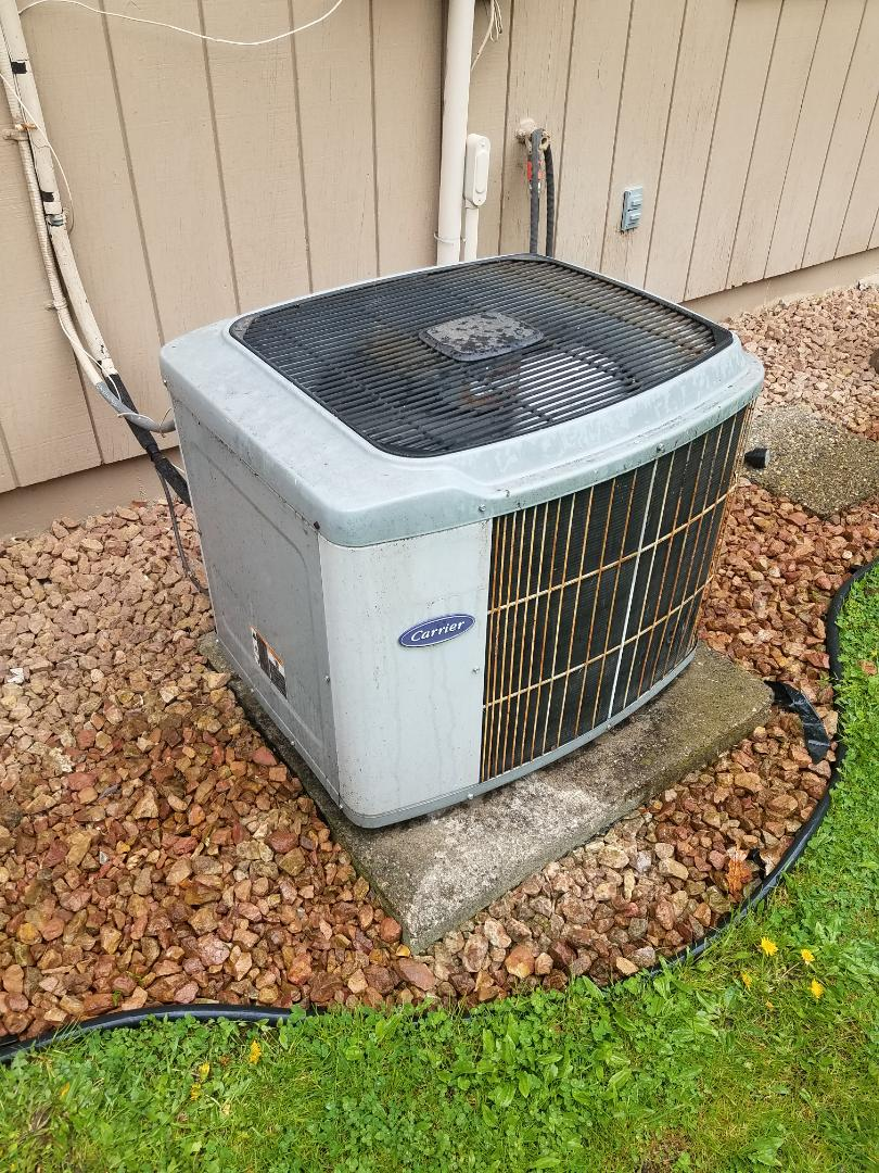 Corcoran, MN - AC maintenance. Diagnosed a plugged drain  line on a Carrier AC.