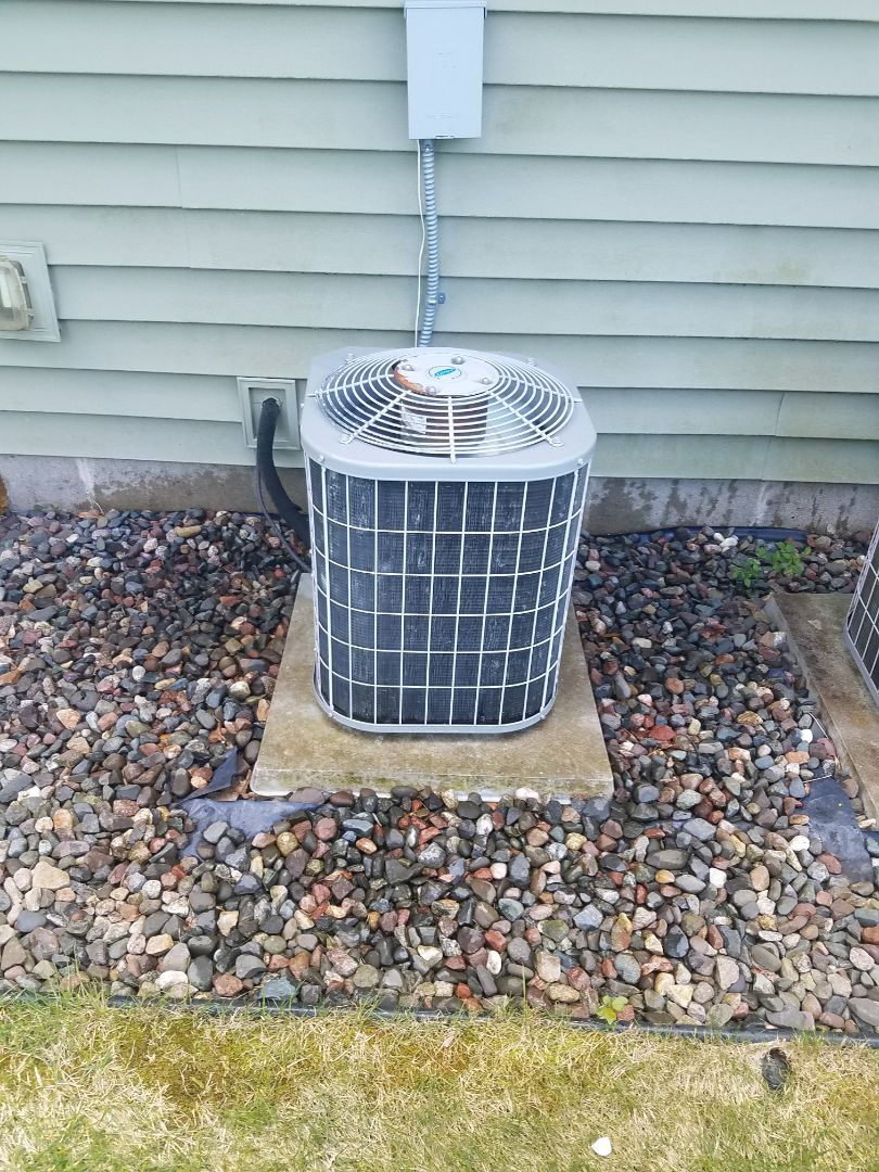 Monticello, MN - AC maintenance. Performed tune up and cleaning on a Carrier AC.