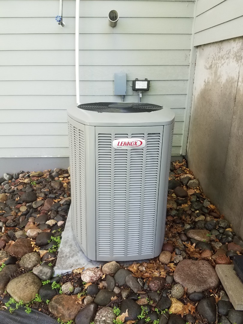 Wayzata, MN - AC maintenance. Performed tune up and cleaning on a Lennox AC.