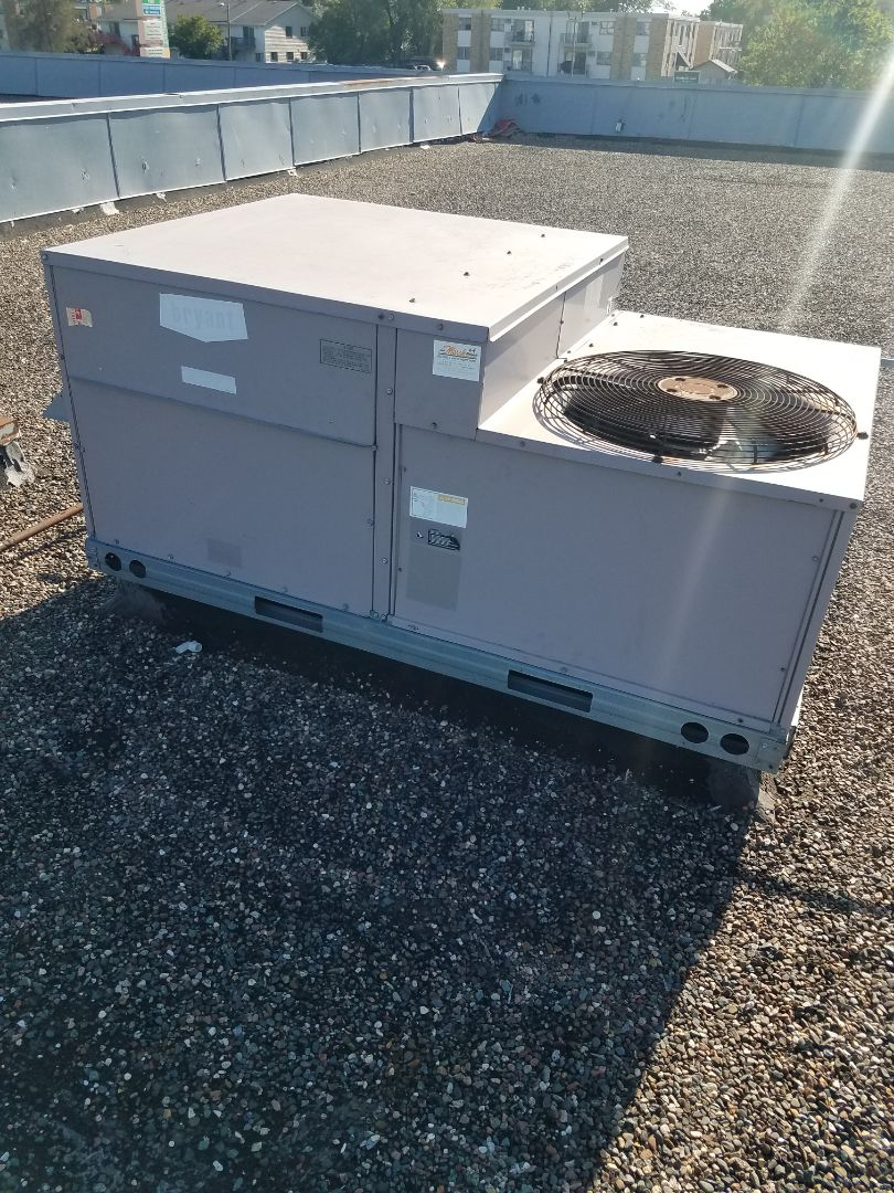 Brooklyn Center, MN - RTU maintenance. Balanced refrigerant charge and repaired a burnt wire on a Bryant RTU