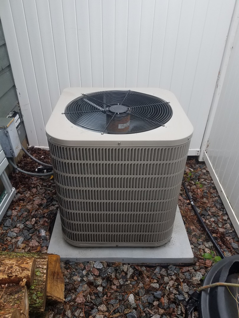 Delano, MN - Cooling maintenance. Performed cleaning and tune up on a Goodman air conditioner.