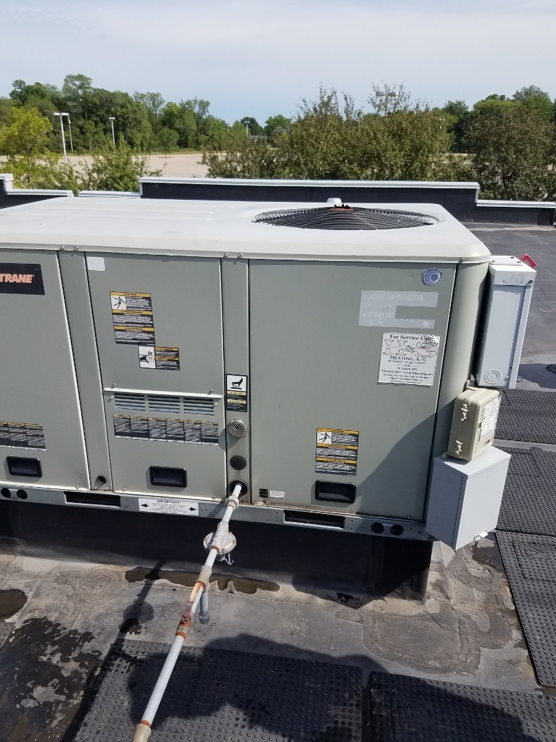 Buffalo, MN - RTU maintenance. Diagnosed a Trane RTU. Installed a leak sealant, locking refrigerant caps and balanced refrigerant charge.