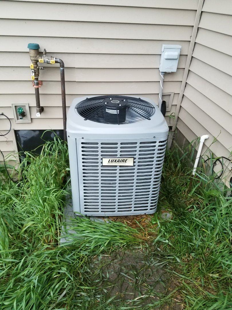 Hanover, MN - Cooling maintenance. diagnosed low charge on a Luxaire air conditioner.