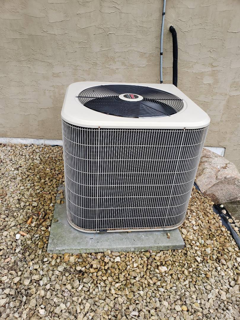 Hanover, MN - Cooling maintenance. Performed tune up and cleaning on an Amana air conditioner.