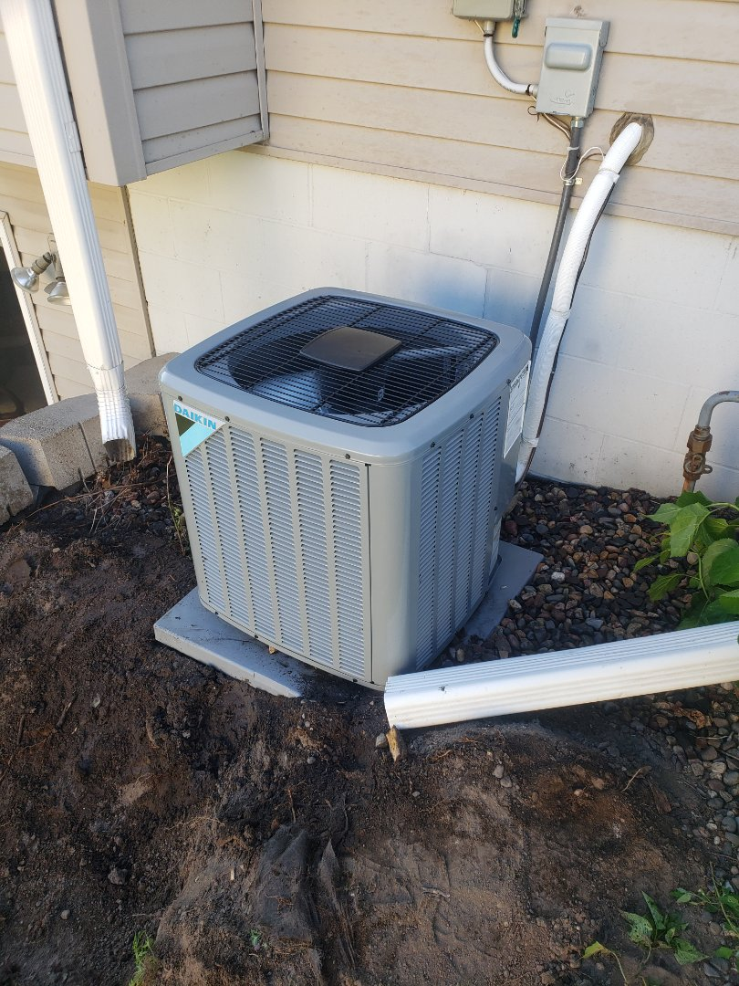 Ramsey, MN - Cooling maintenance installed a new AC motor booster and performed a cleaning and tune up on a Daikin air conditioner