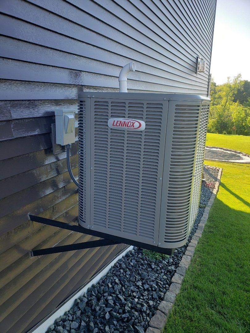 Dayton, MN - AC maintenance. Performed cleaning and tune up on a Lennox AC.