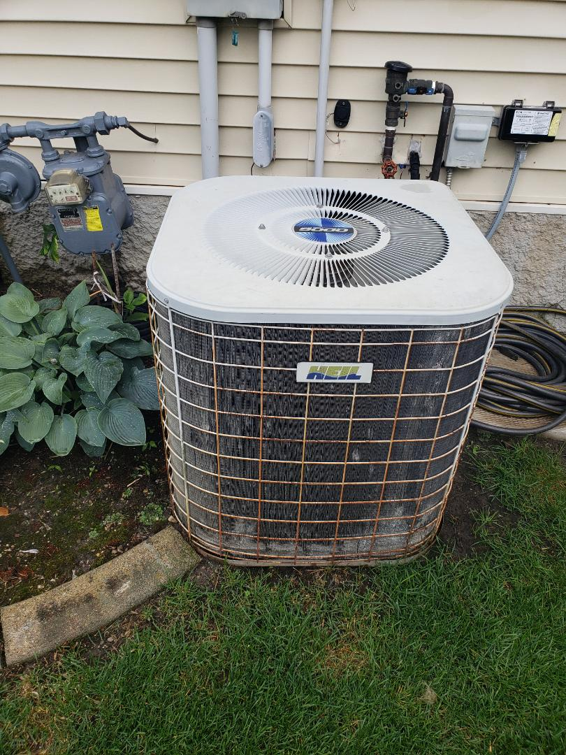 Rogers, MN - Cooling maintenance. Repaired a low voltage wire on a Heil air conditioning.