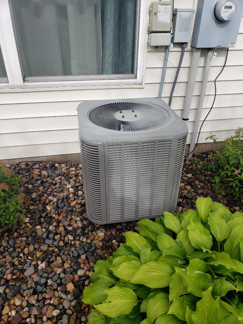 Plymouth, MN - AC maintenance. Performed tune up and cleaning on a Lennox AC.