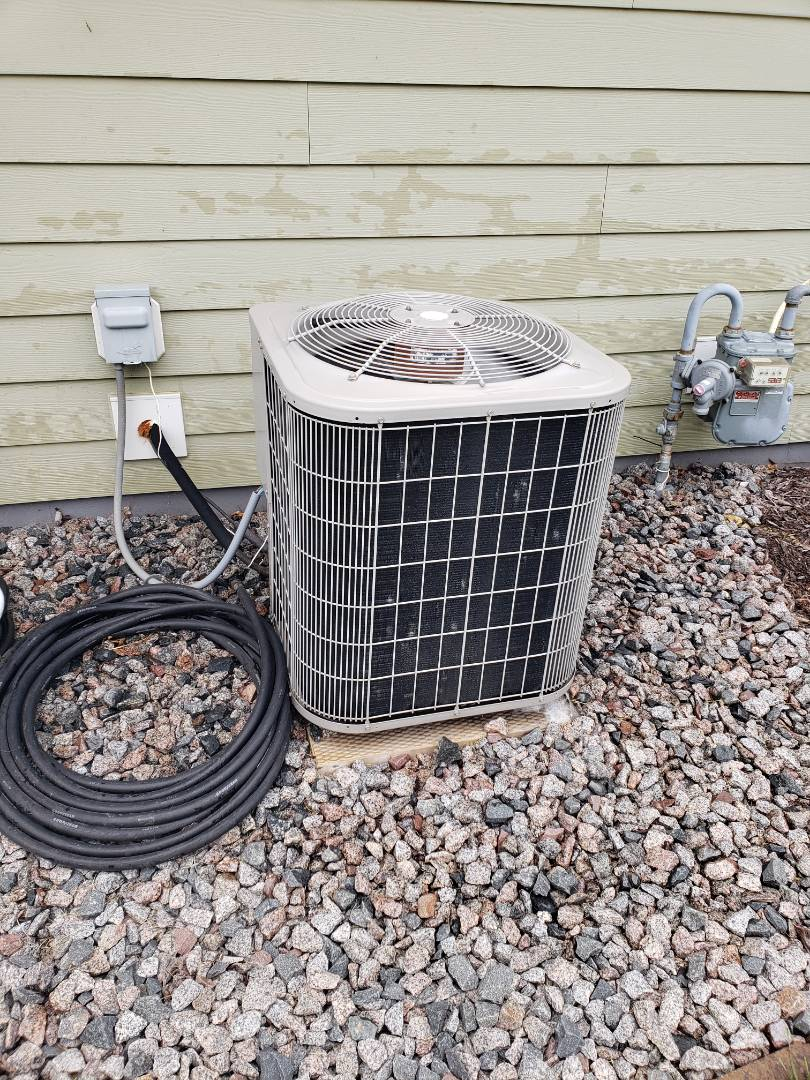Rogers, MN - Cooling maintenance. Performed cleaning and tune up on a Bryant air conditioner.