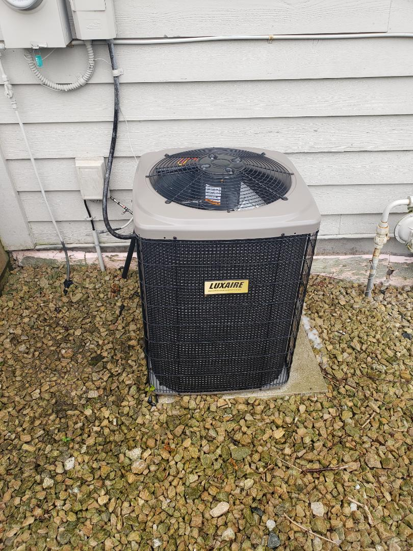 Rogers, MN - AC maintenance. Replaced outdoor fan motor and performed tune up and cleaning on a Luxaire AC.