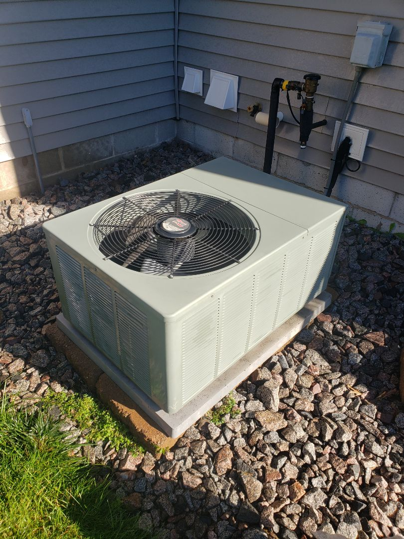 Elk River, MN - AC maintenance. Performed tune up and cleaning on a Ruud AC.