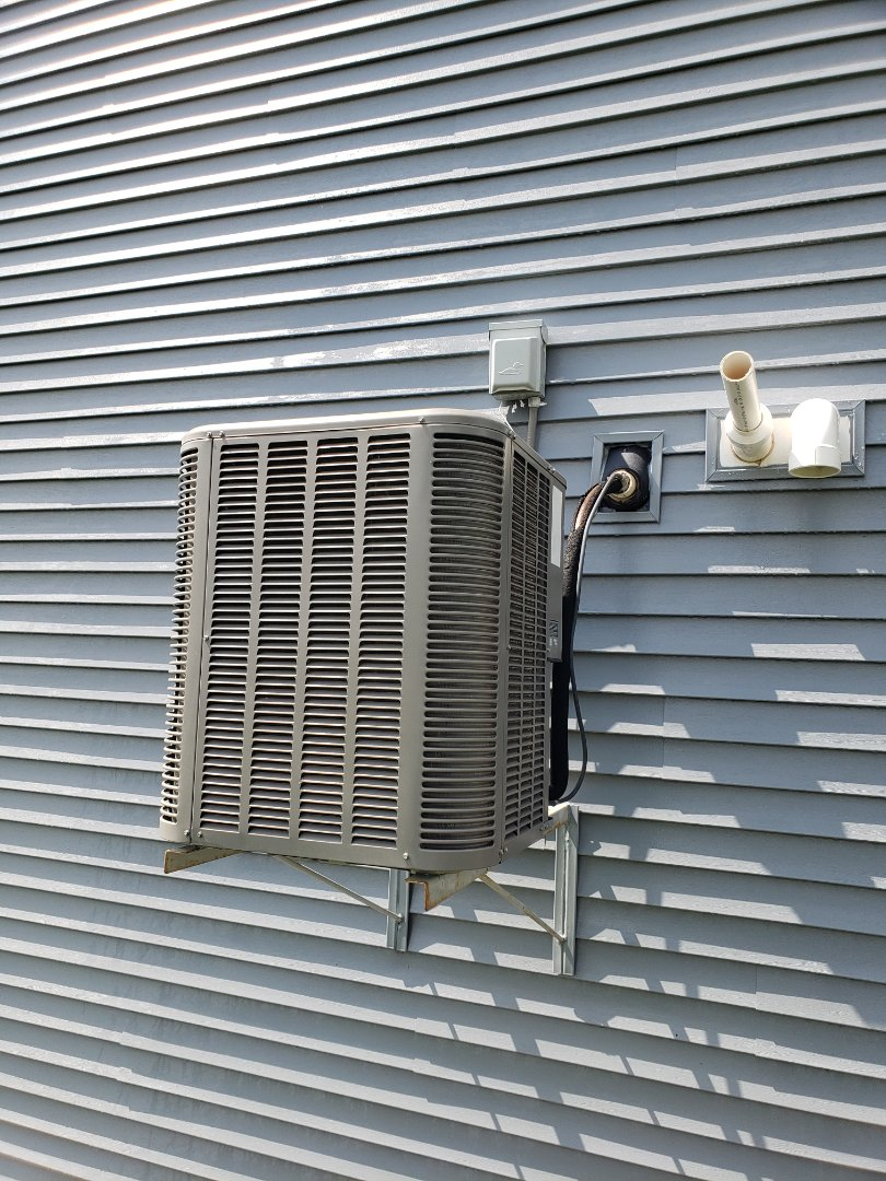 Osseo, MN - Cooling maintenance. Performed cleaning and tune up on a Lennox air conditioner.