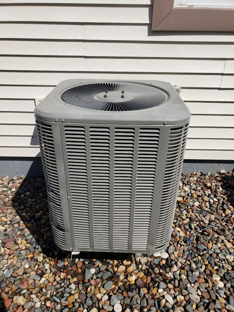 Osseo, MN - AC maintenance. Performed tune up and cleaning on a Lennox AC. Installed 2 Honeywell thermostats.