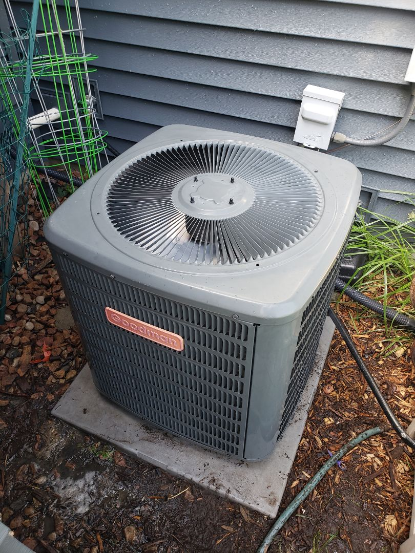 Osseo, MN - Cooling maintenance. Performed cleaning and tune up on a Goodman air conditioner.