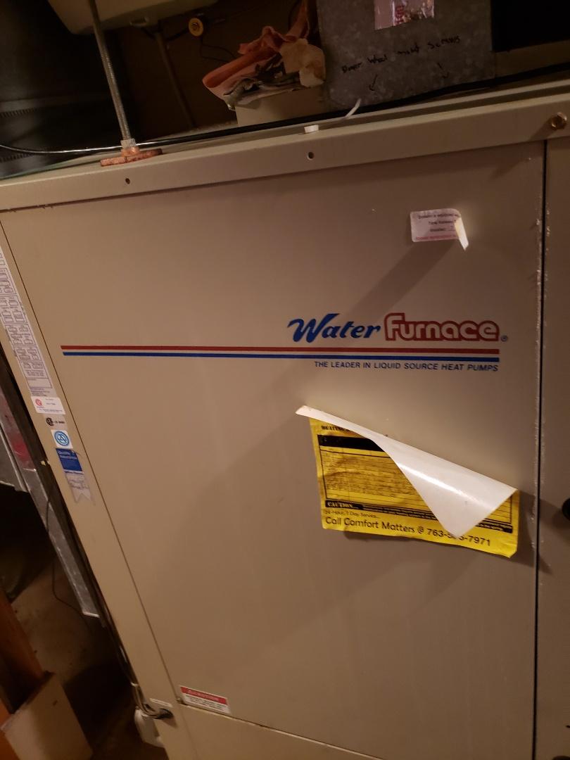 Buffalo, MN - Heat pump maintenance. Installed a new drain line on a Water Furnace heat pump