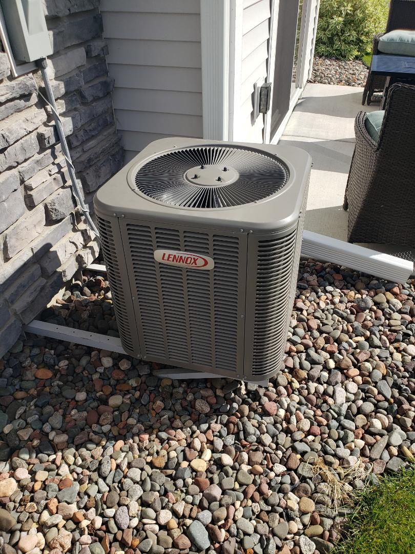 Maple Grove, MN - AC maintenance. I stalled a new outdoor fan motor and fan blades on a Lennox AC. Performed tune up and cleaning.