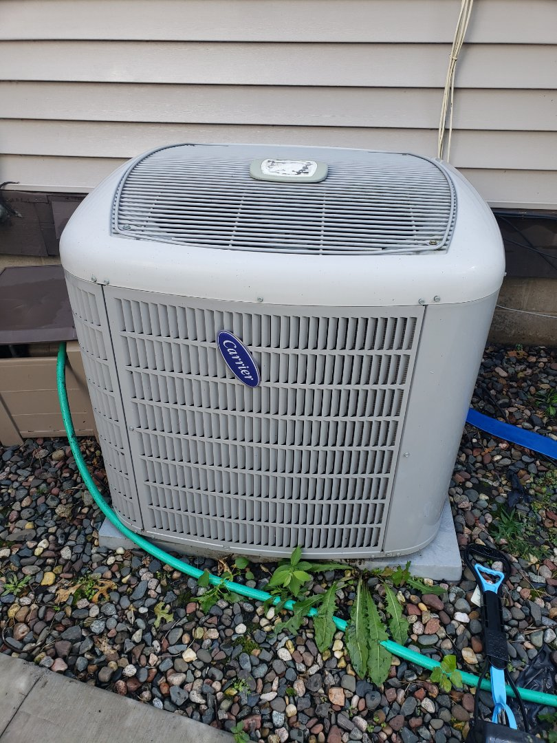 Coon Rapids, MN - Cooling maintenance. Performed cleaning and tune up on a Carrier air conditioner. Installed a new drain line