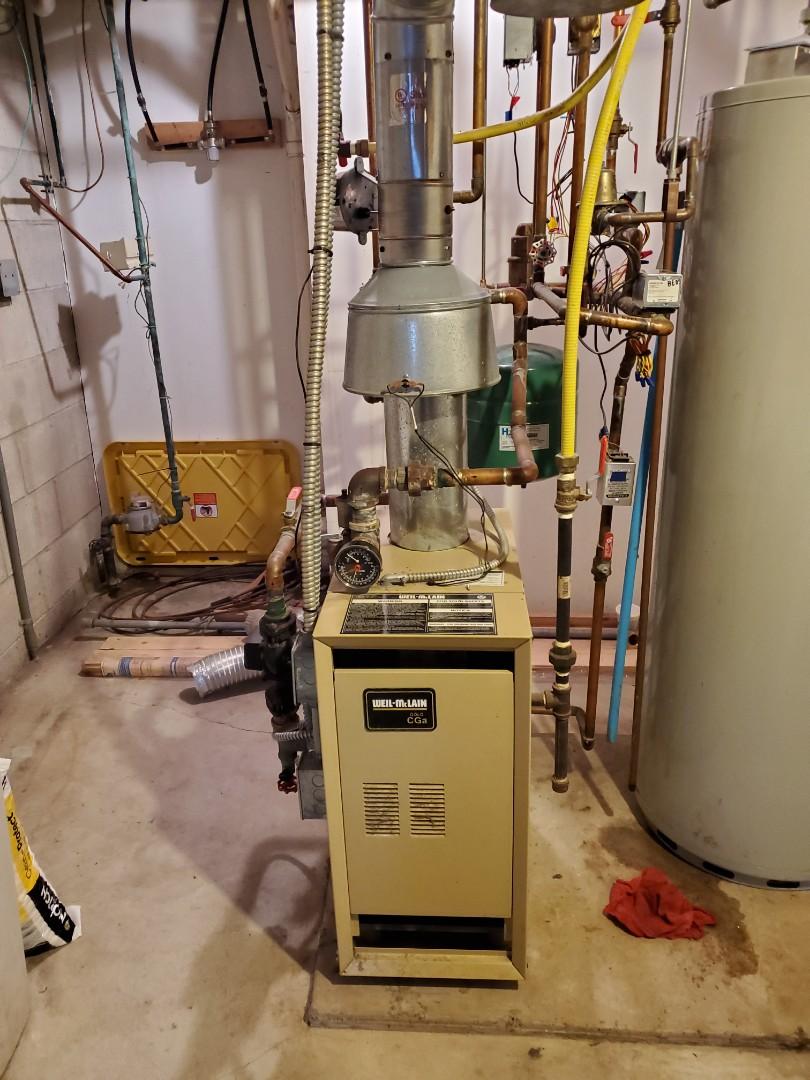 Rockford, MN - Heating service. Installed a Honeywell zone motor head on a Weil-McLain boiler.