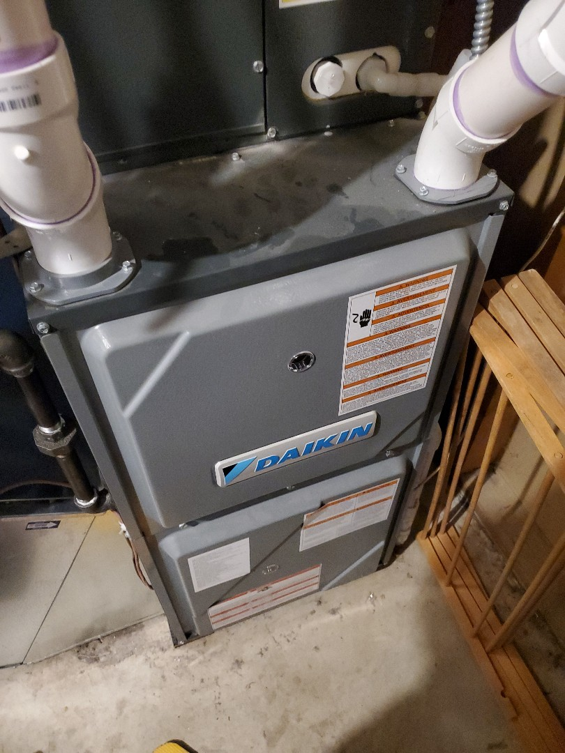Medina, MN - Tune up and cleaning on a Daikin furnace. Changed humidifier water panel.