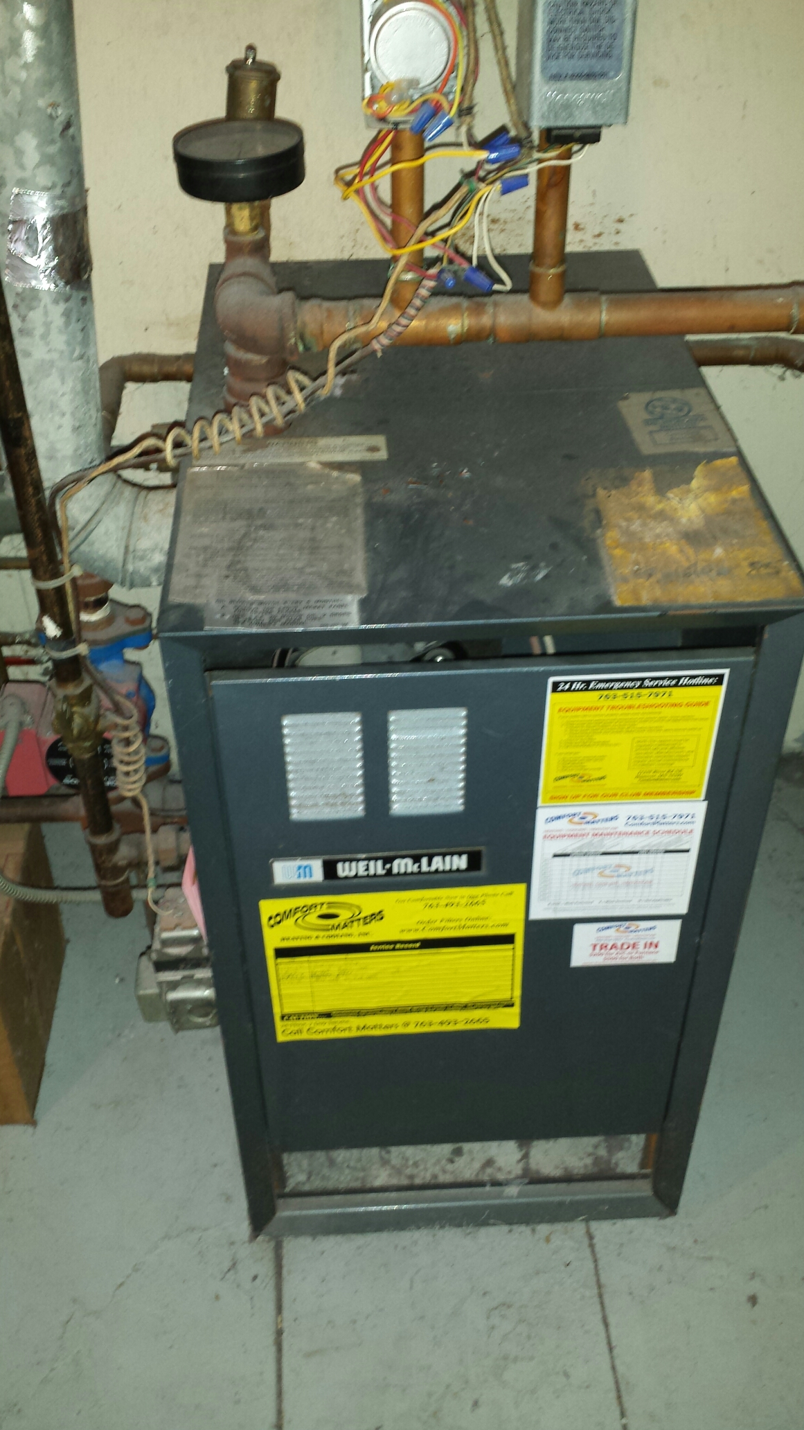 Fridley, MN - Heating service. Replaced a Honeywell thermostat on a Weil McLain boiler system.