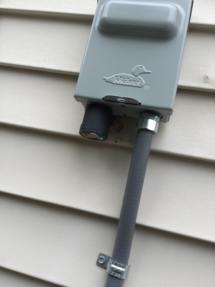 Elk River, MN - Installed surge protector on air conditioner