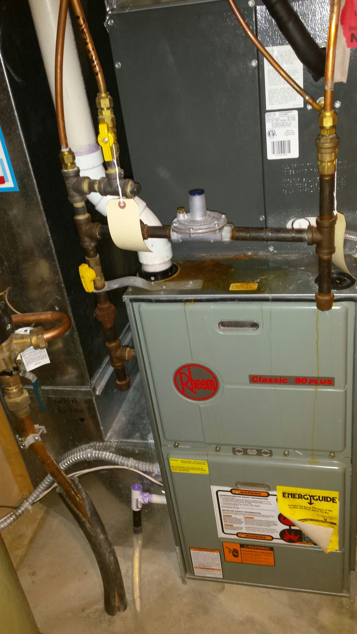 Andover, MN - Furnace maintenance tune up and cleaning on a Rheem furnace