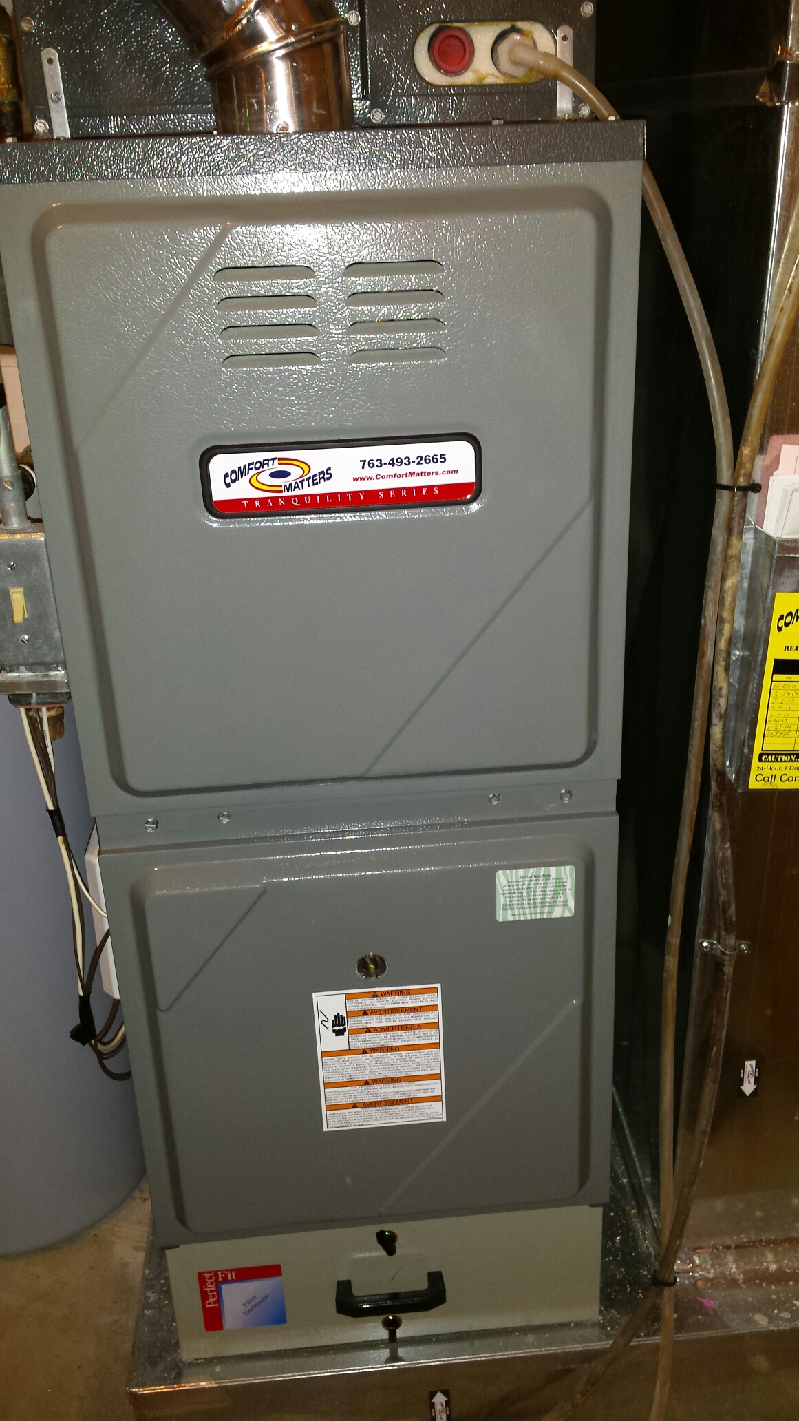 Fridley, MN - Furnace maintenance tune up and cleaning on a Comfort Matters furnace