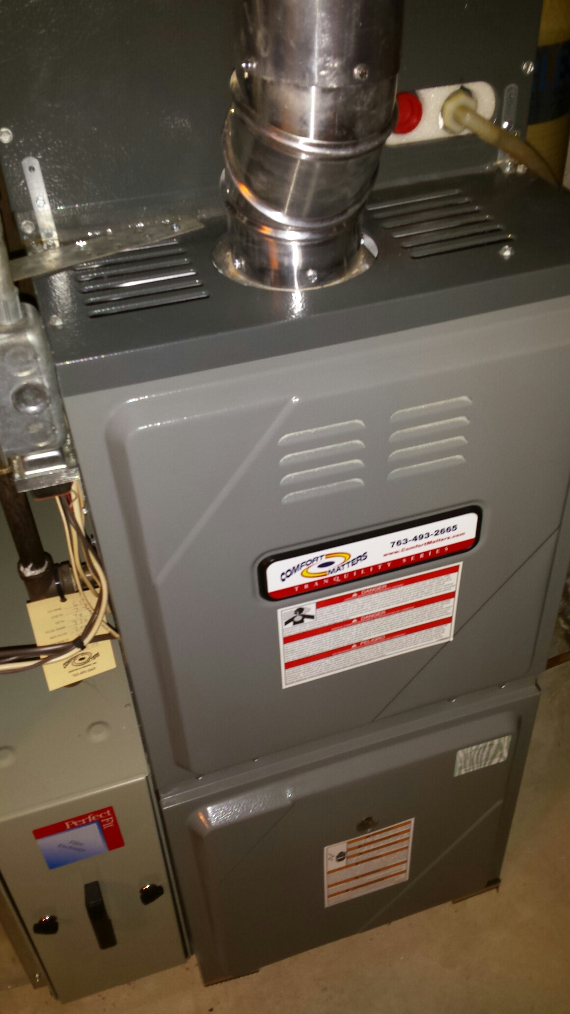 Fridley, MN - Furnace maintenance tune up and cleaning on a Comfort Matters furnace and Trane humidifier