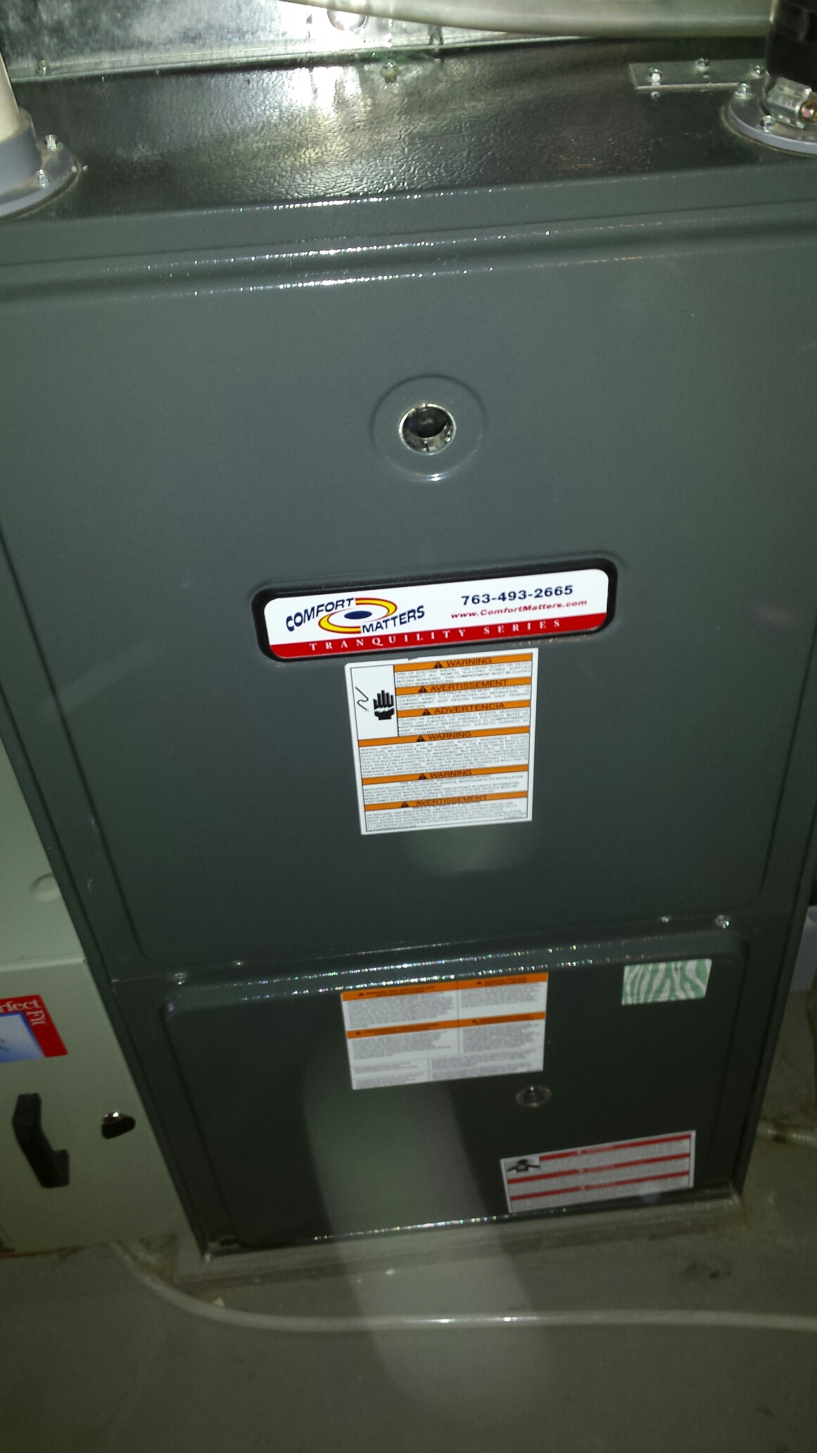 New Hope, MN - Furnace maintenance tune up and cleaning on a Comfort Matters furnace